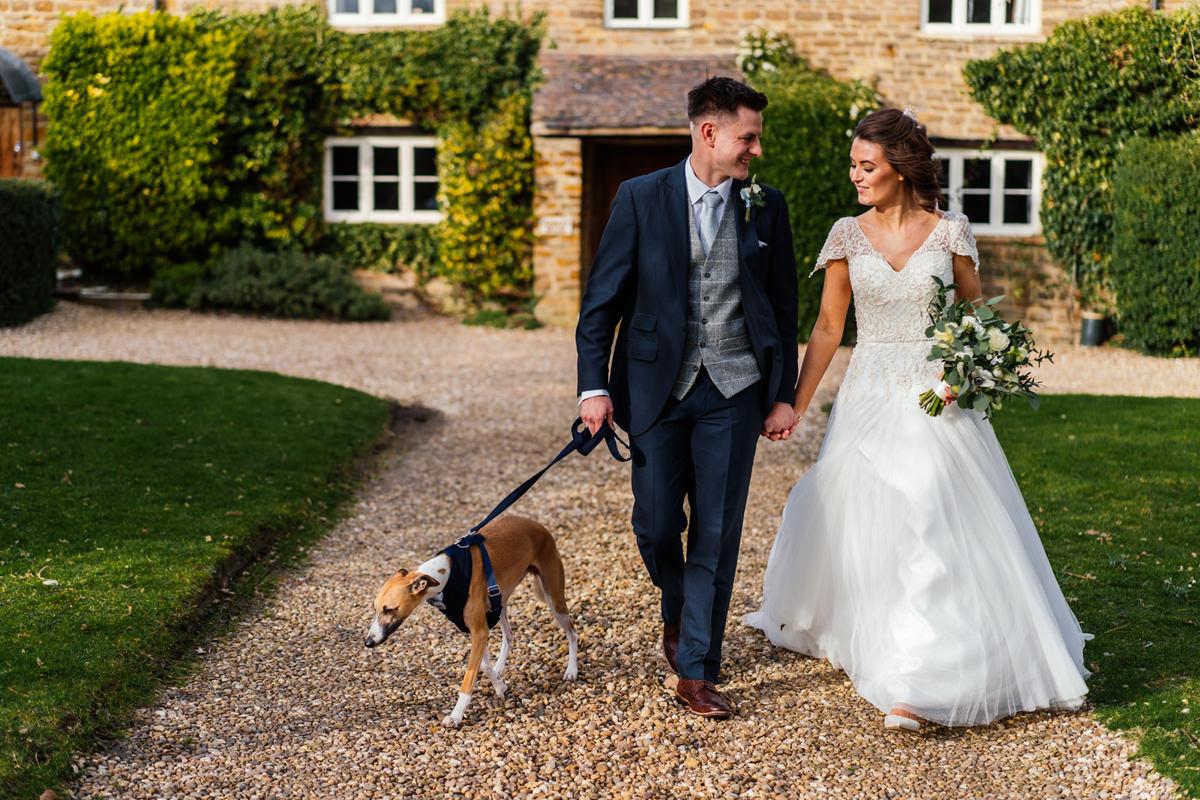 Bride & Groom walk their dog on their wedding day