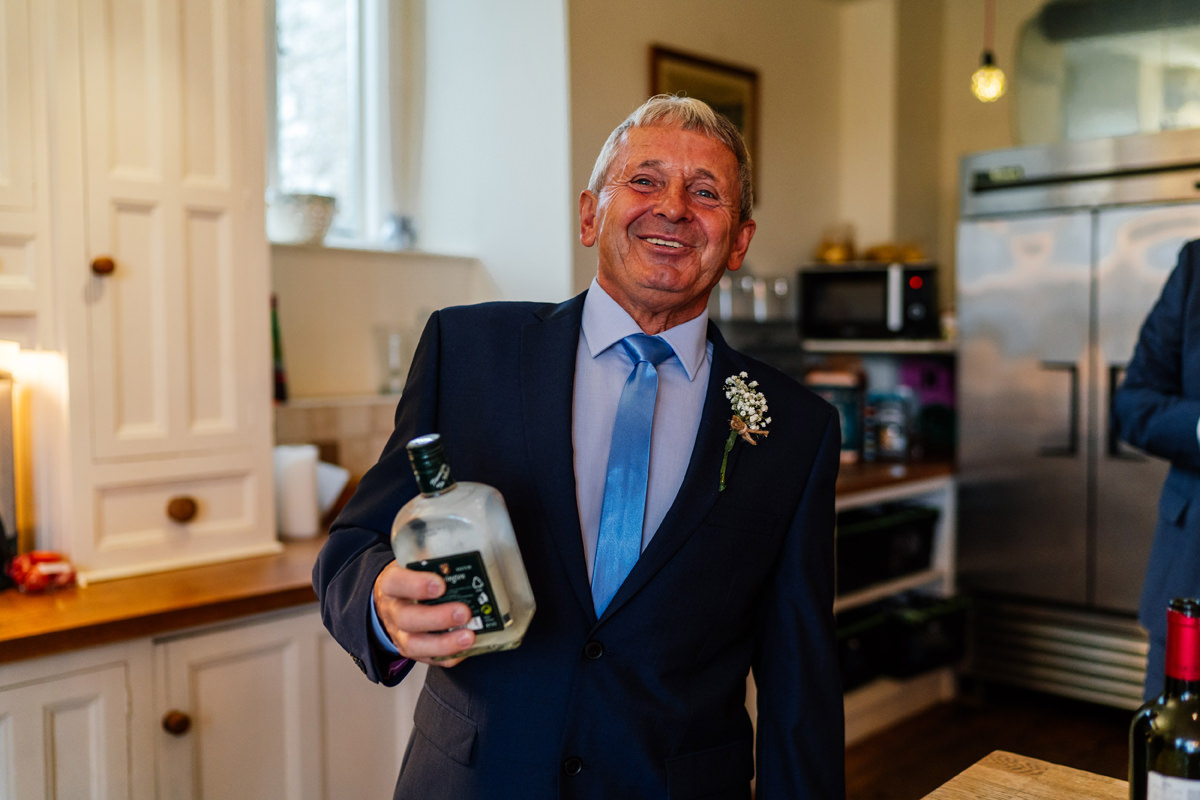 uncle of the bride sharing his polish vodka trying to get all the guests drunk