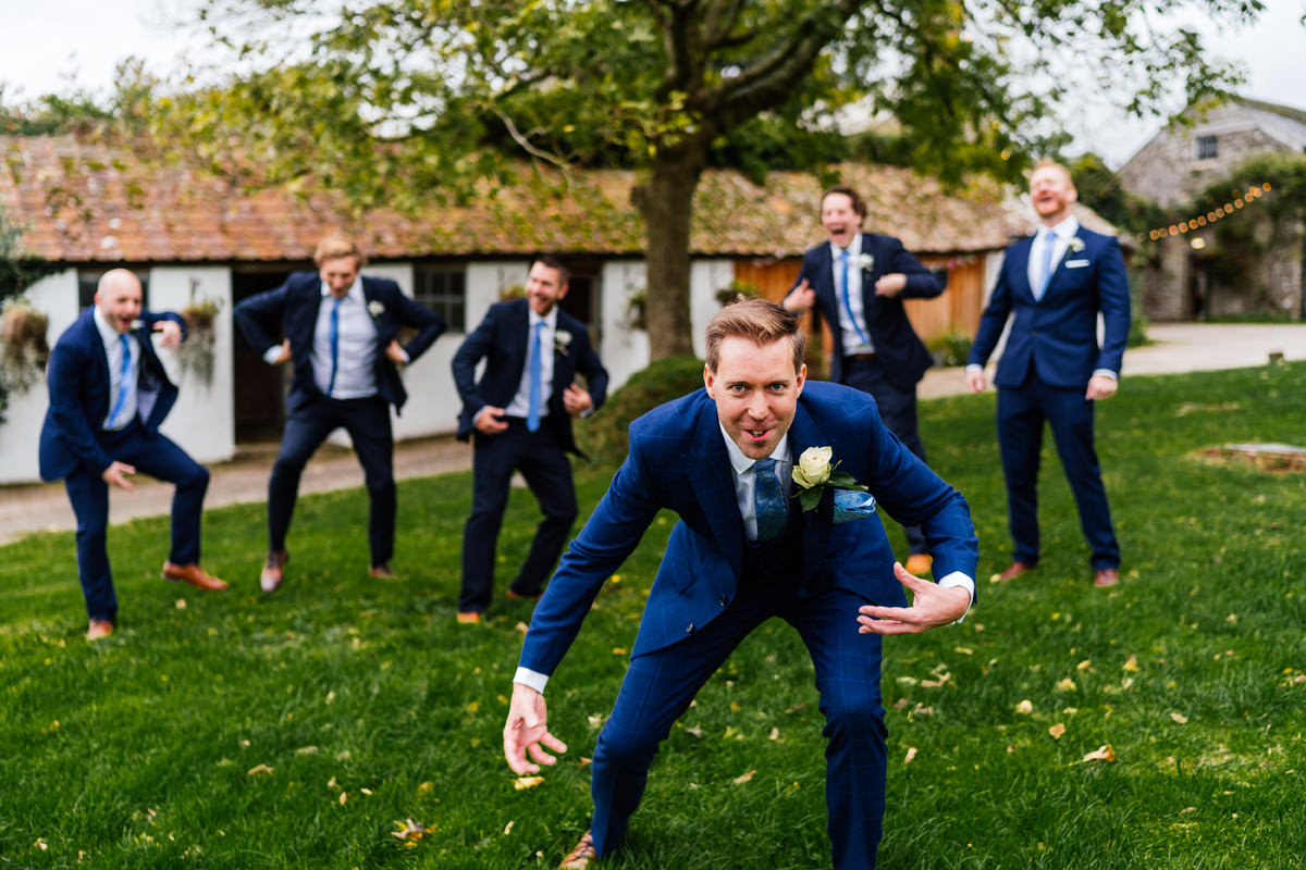 groom and his groomsmen doing the monkey