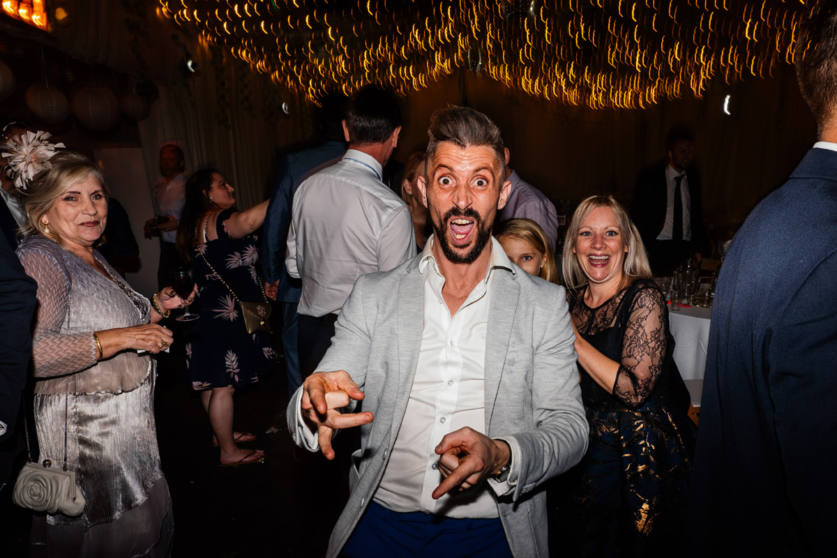 wedding guest with crazy face