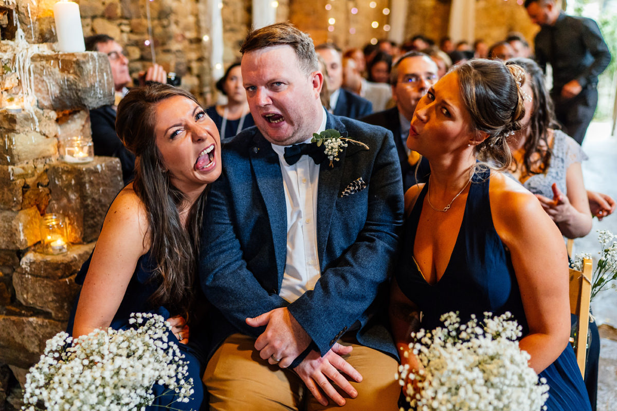 bridal party pulling funny faces during the ceremony
