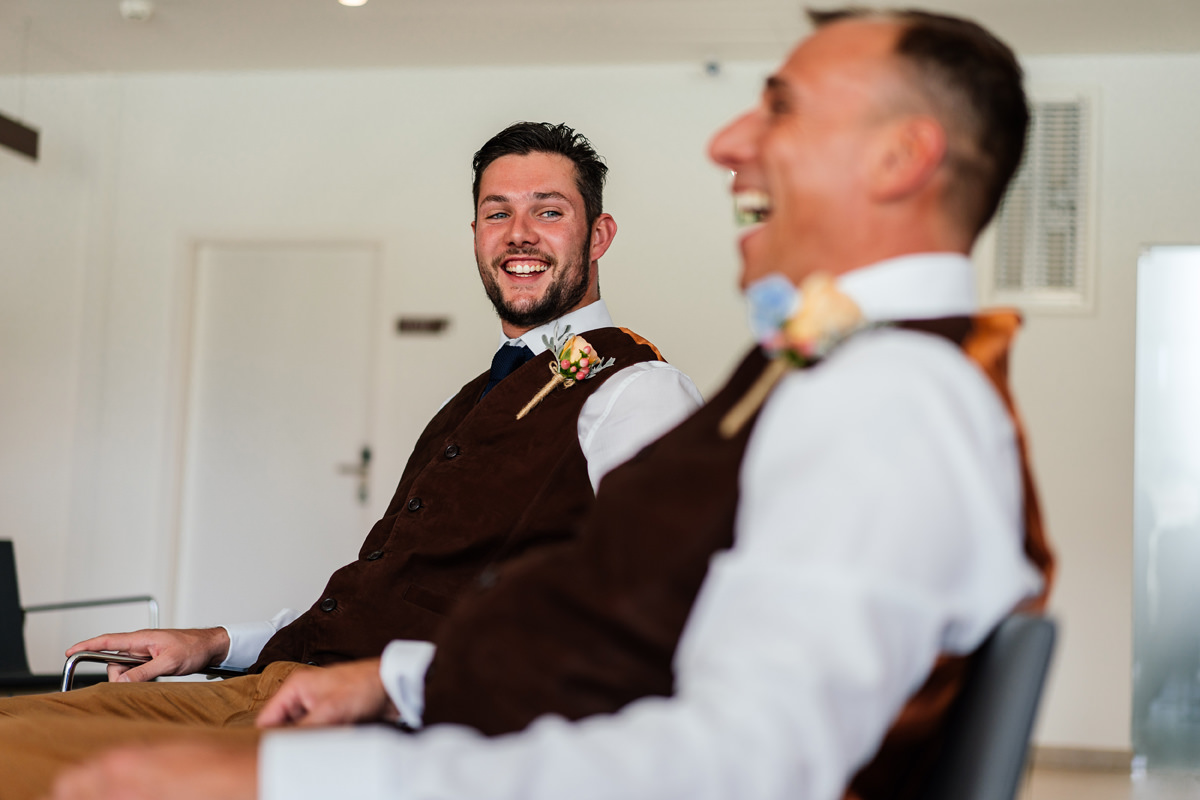groom and best man laughing before wedding ceremony