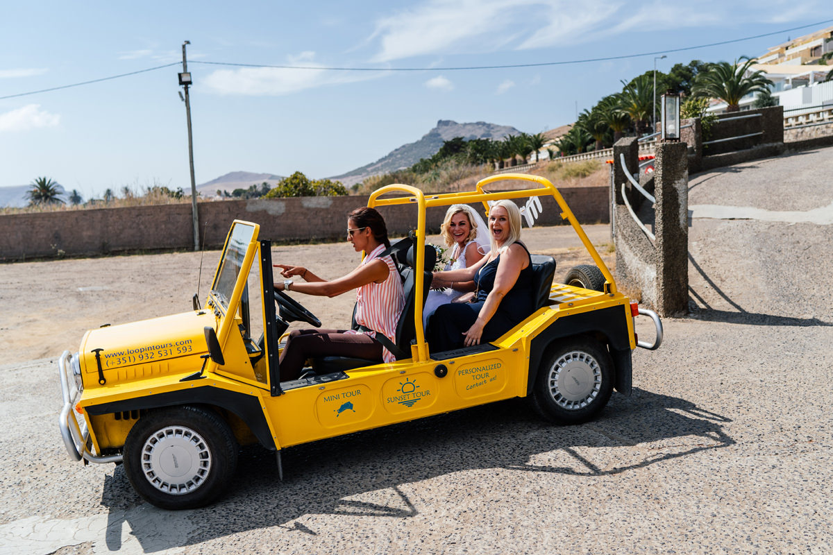 Mini Moke arrives with bride and bridesmaid