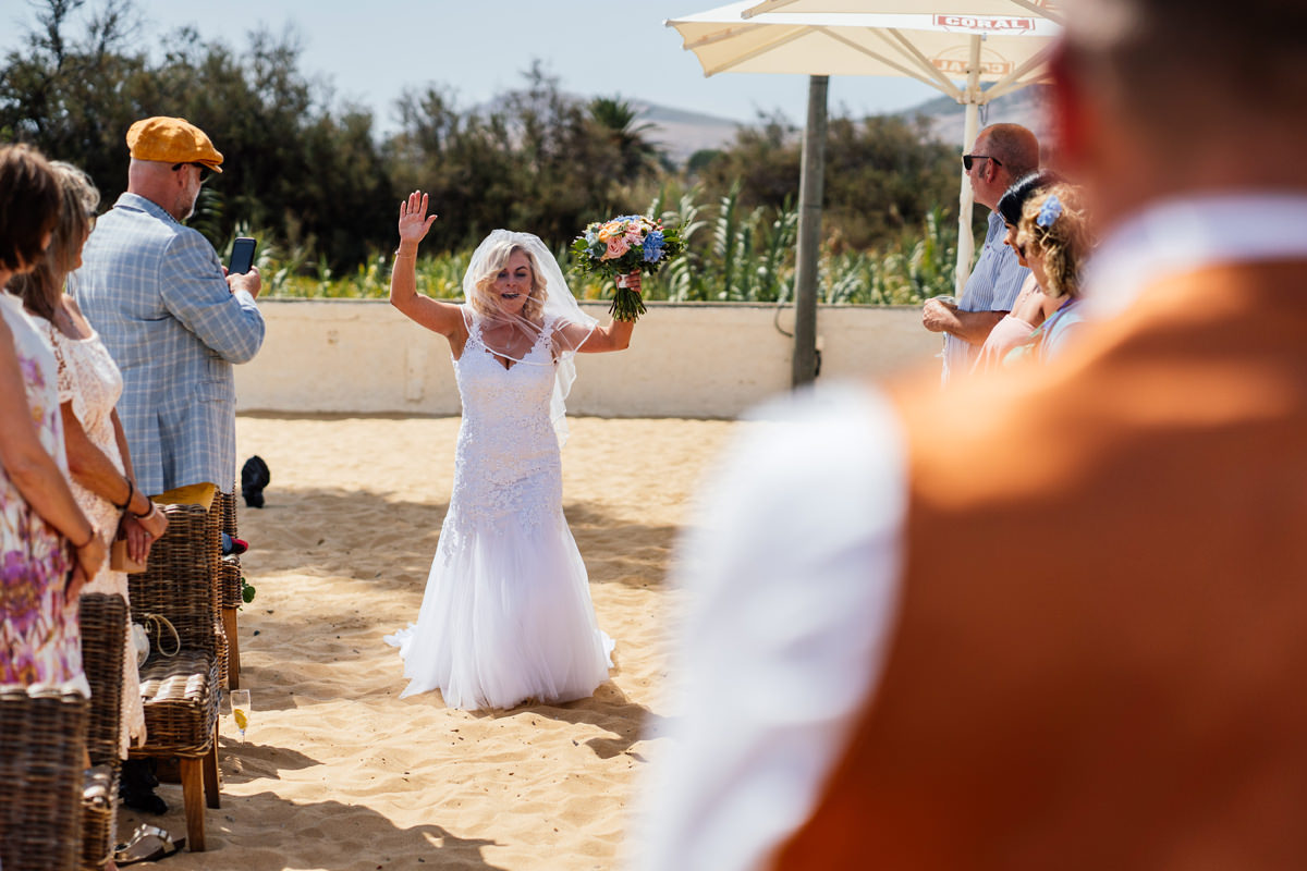 bride arrives at the beachside ceremony