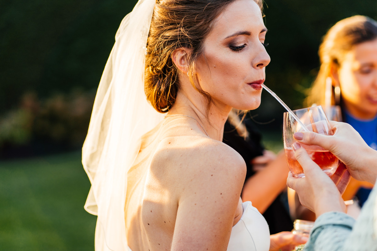 bride enjoying the drinks during the reception