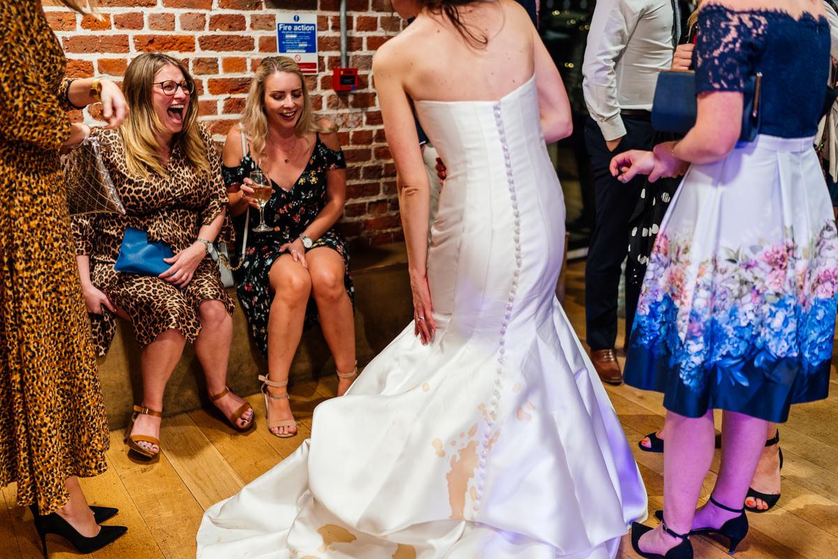 when the espresso martini gets spilt down the brides wedding dress
