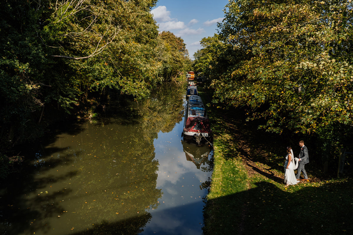 bride and groom walk the canal at Dodmoor House
