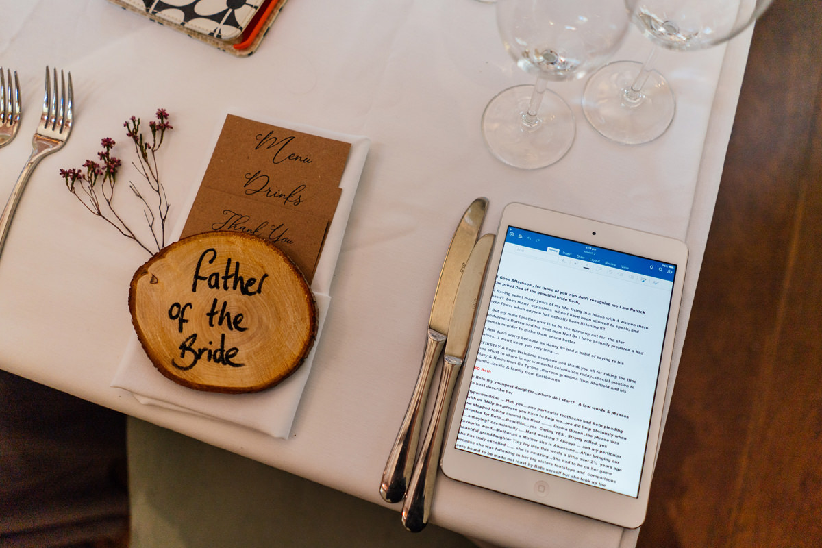 wedding details and father of the bride speech on his iPad