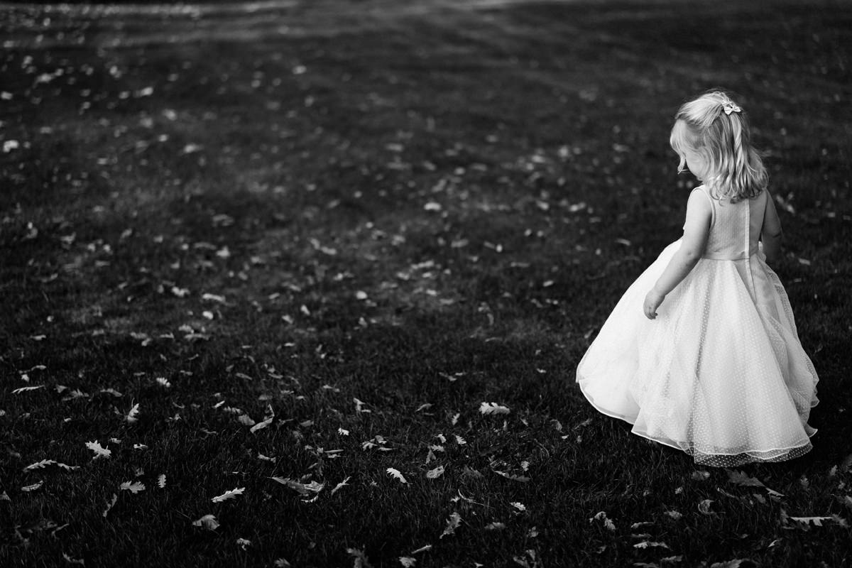 Bride and Groom's daughter playing outside