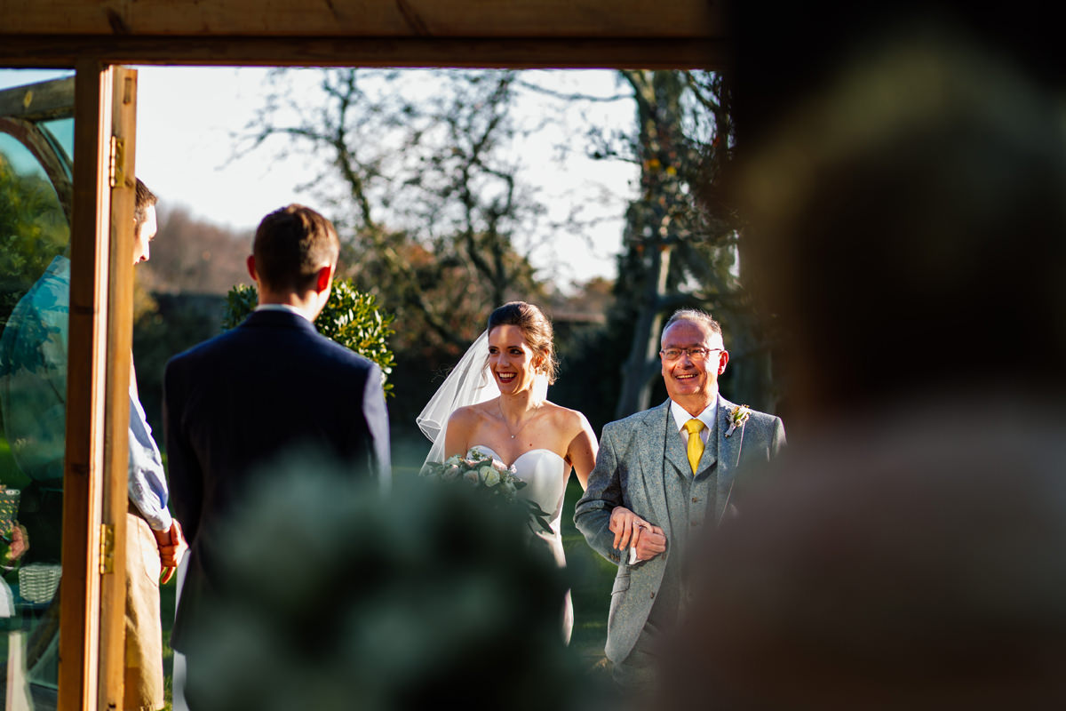 groom meets his bride at the door of the orangery at Gaynes Park