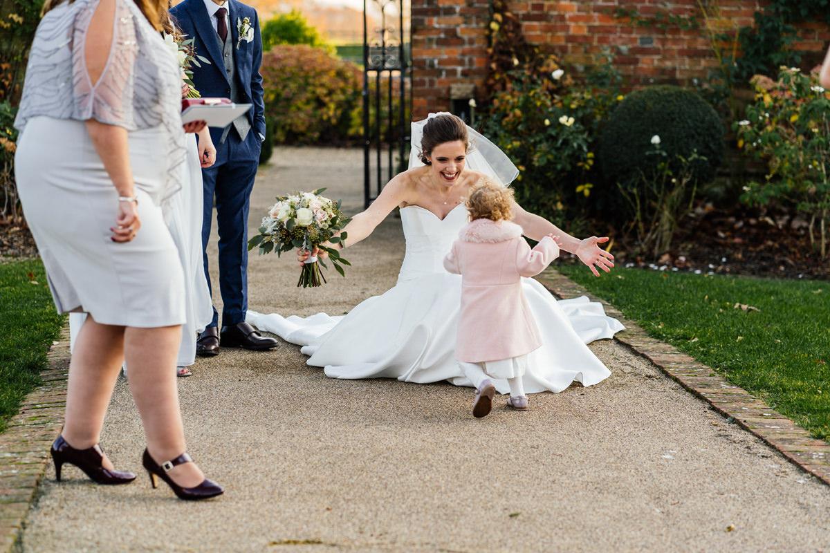 flower girl running up to bride