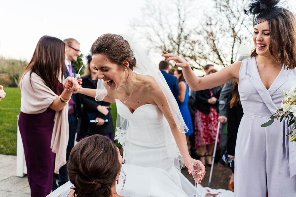 bride trying to get rid of the confetti