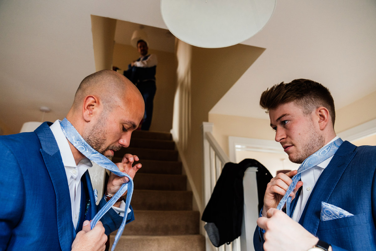 Groomsmen getting ready on morning of wedding