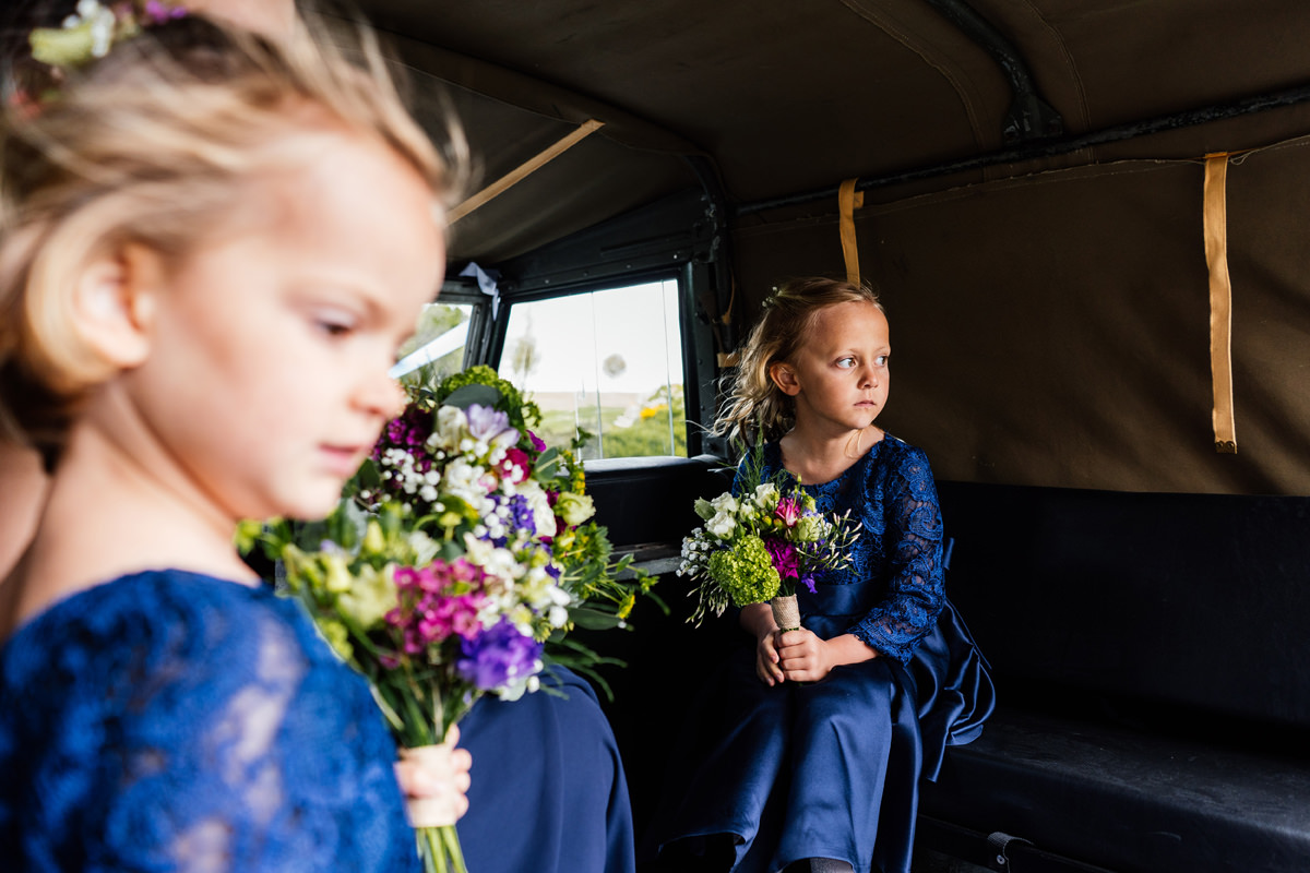 flower girls on land rover to get to the church