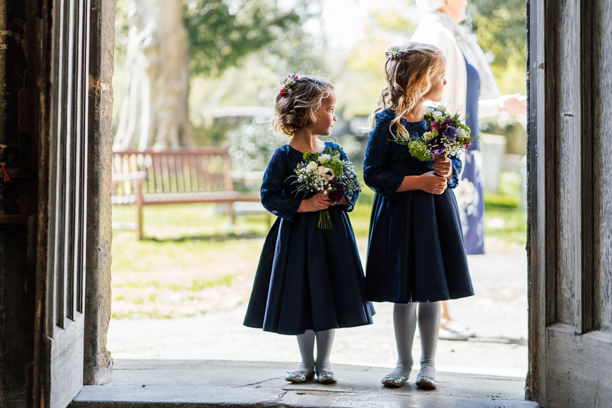 flower girls waiting to enter the church
