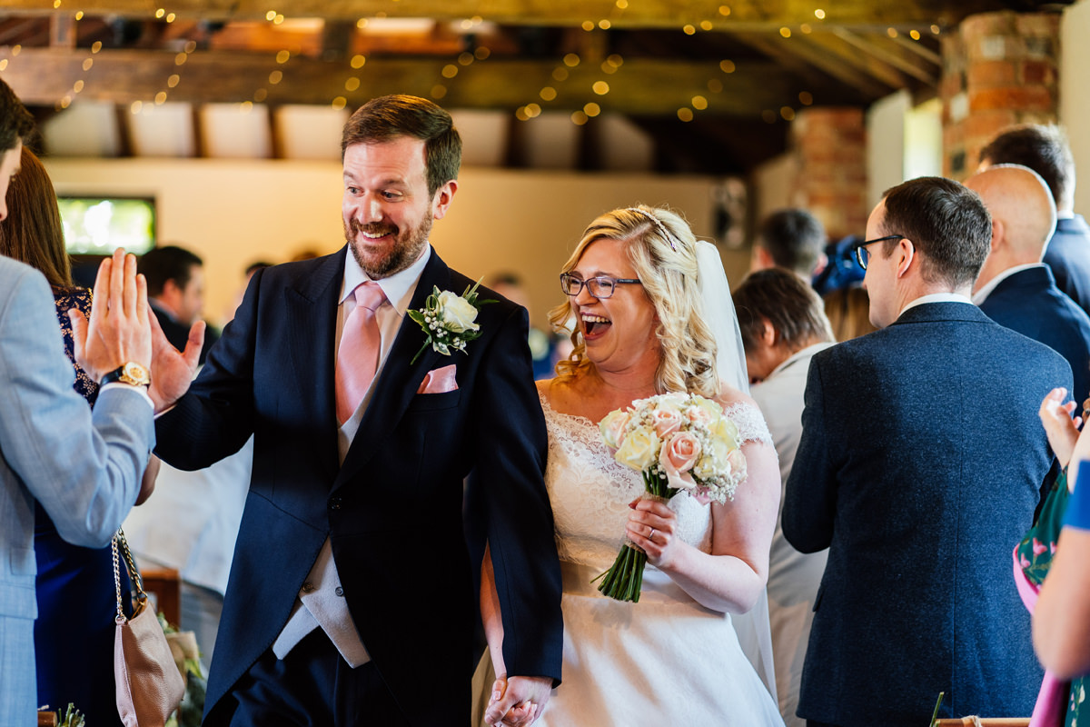 bride and groom walk down the aisle at dodmoor house