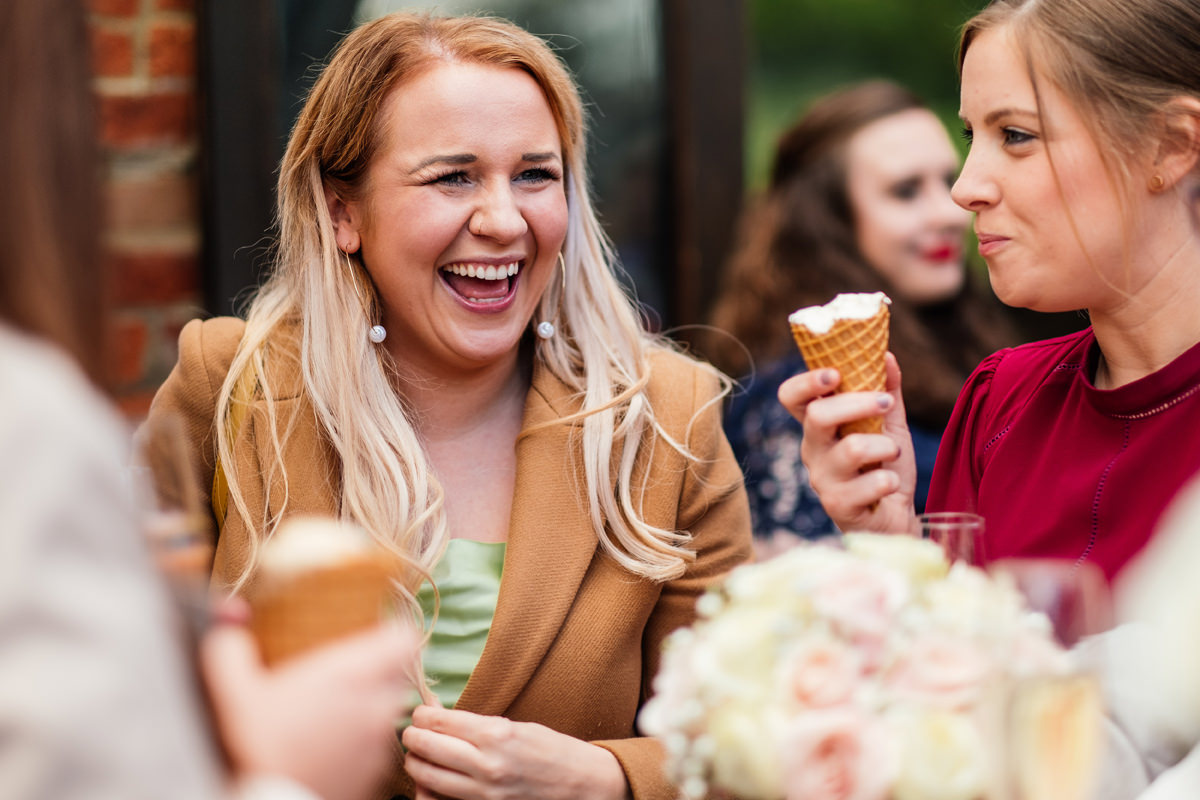 wedding guests enjoying ice creams during the drinks reception