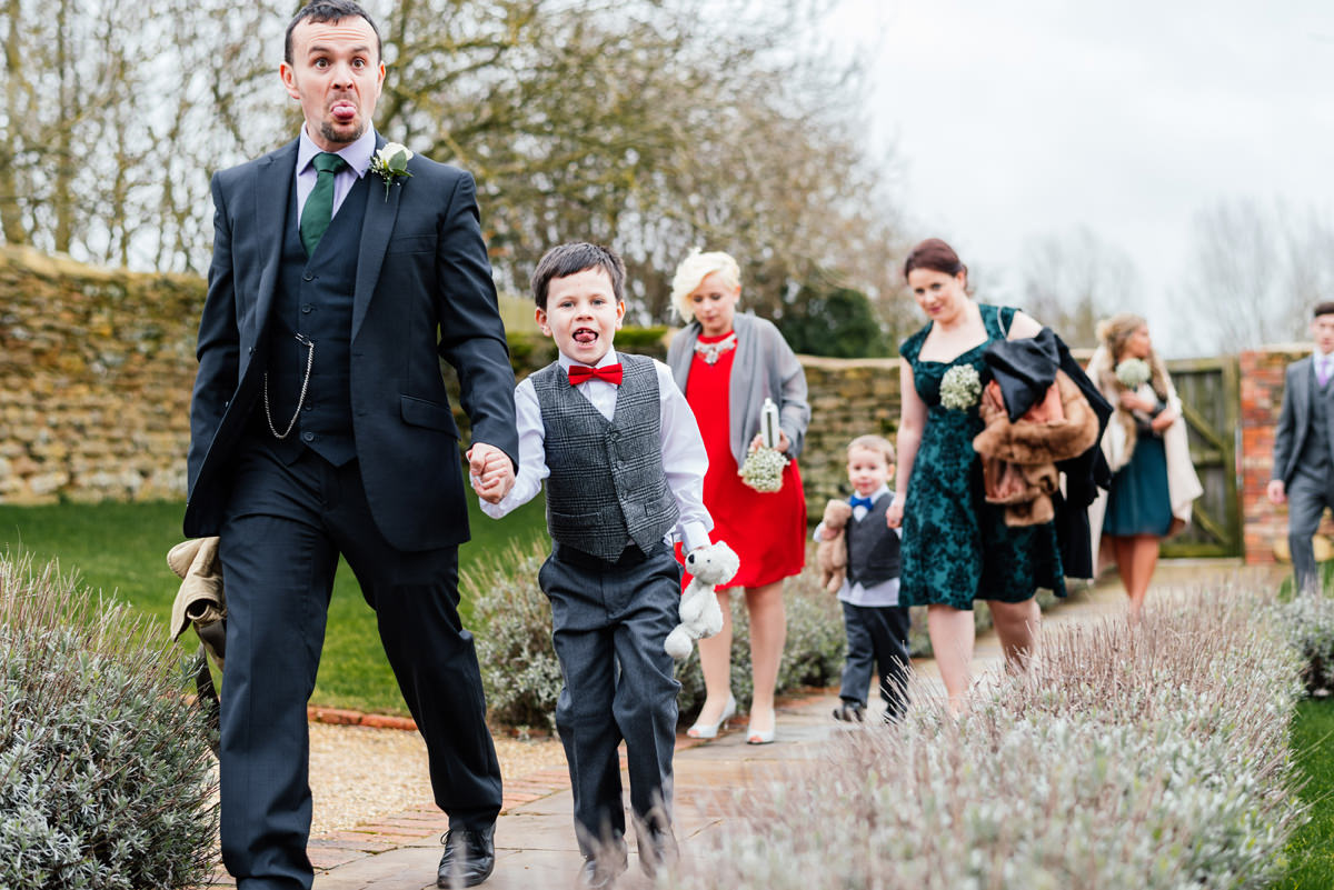 Guests arriving at Dodford Manor for a wedding ceremony