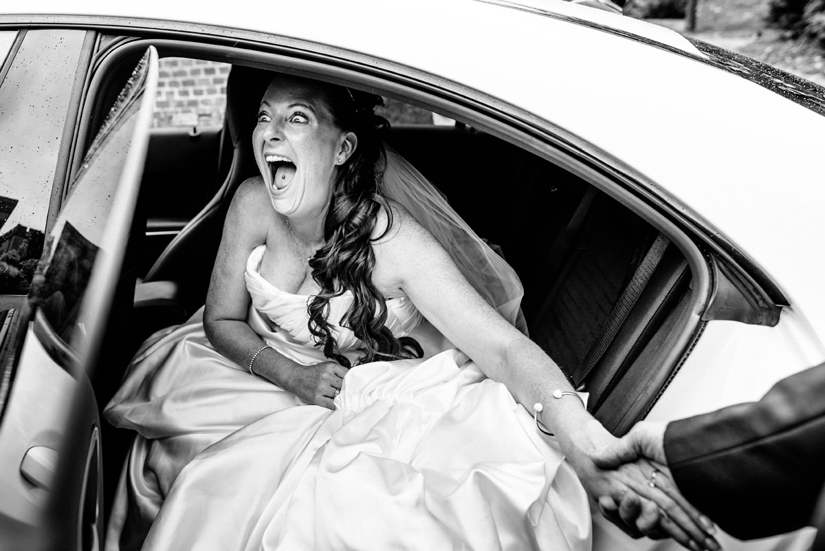 bride excited as she arrives for her wedding