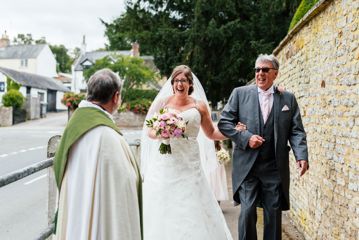 Bride arrives at the church with her dad