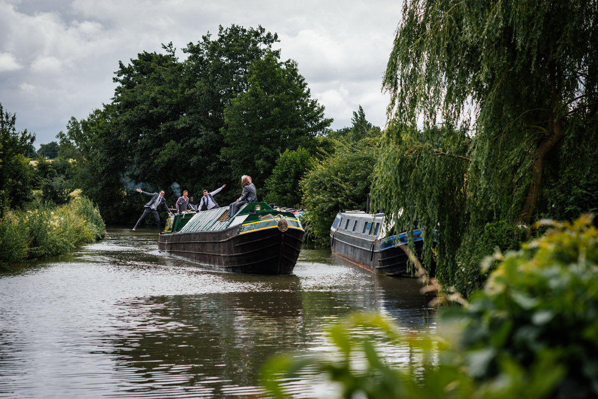groomsmen arriving on a canal boat