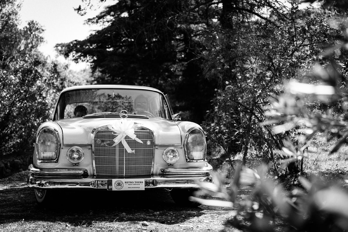 bride arrives at the gentilini retreat in a vintage mercedes benz