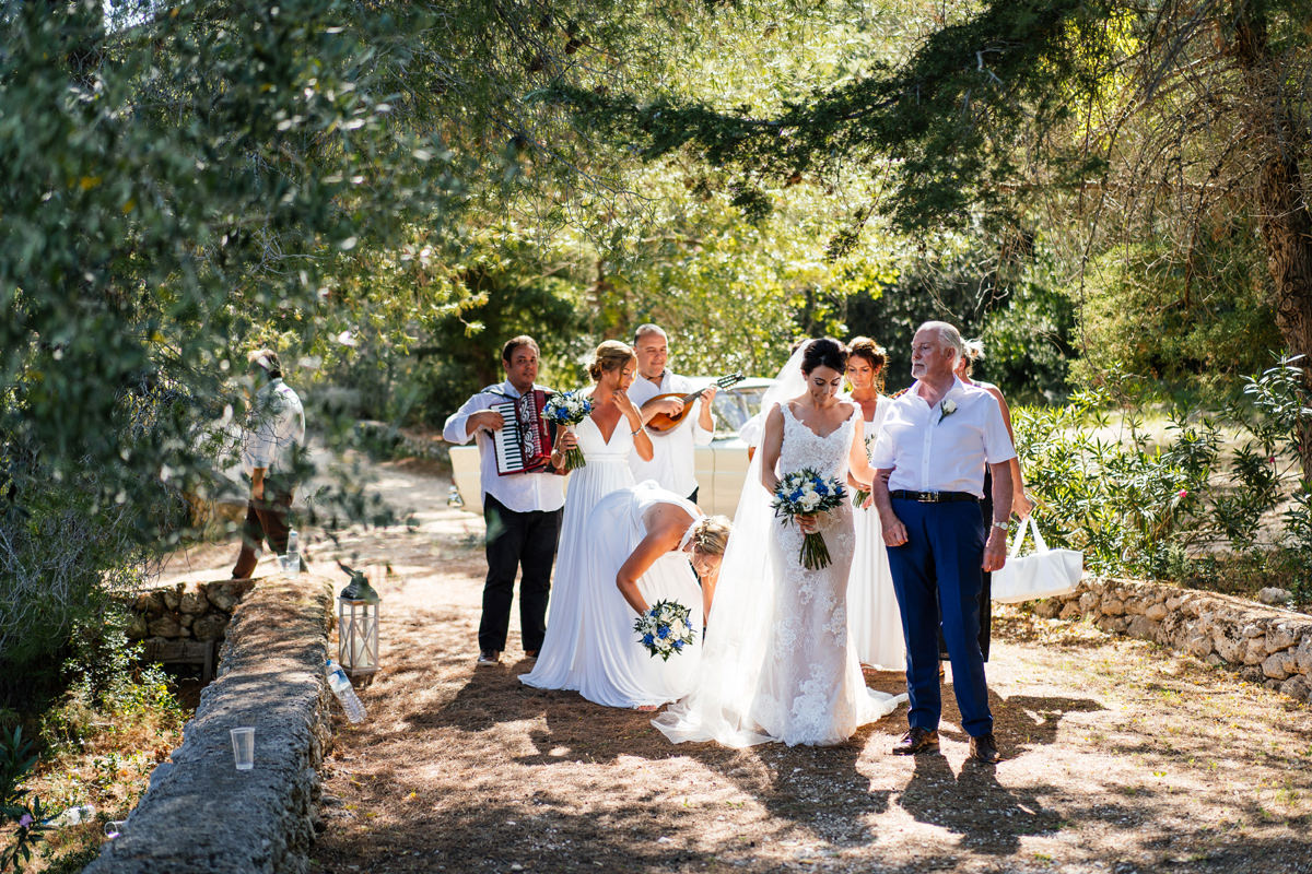 bride and her father walking down the aisle towards the ceremony