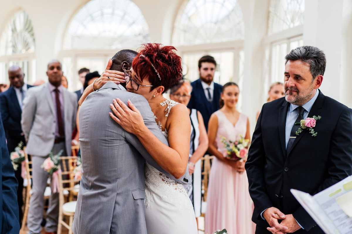emotional bride having a hug from her new husband