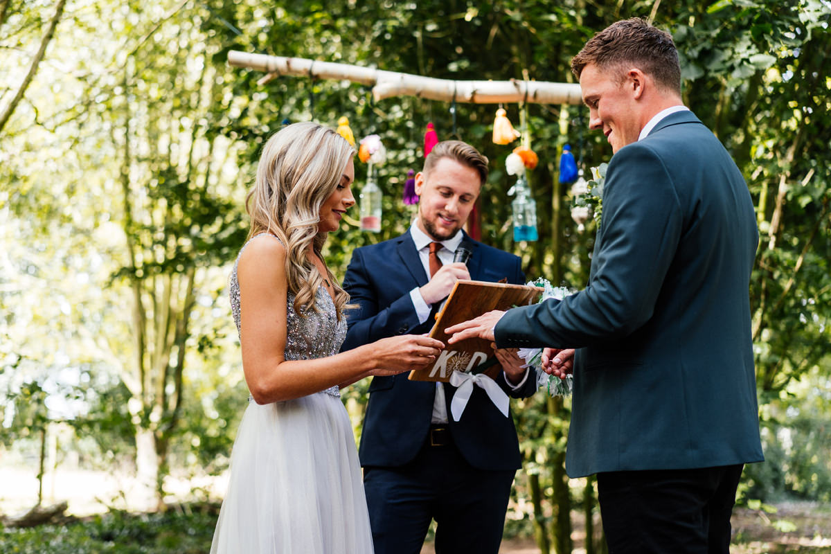 Outdoor wedding ceremony bride and groom exchanging rings