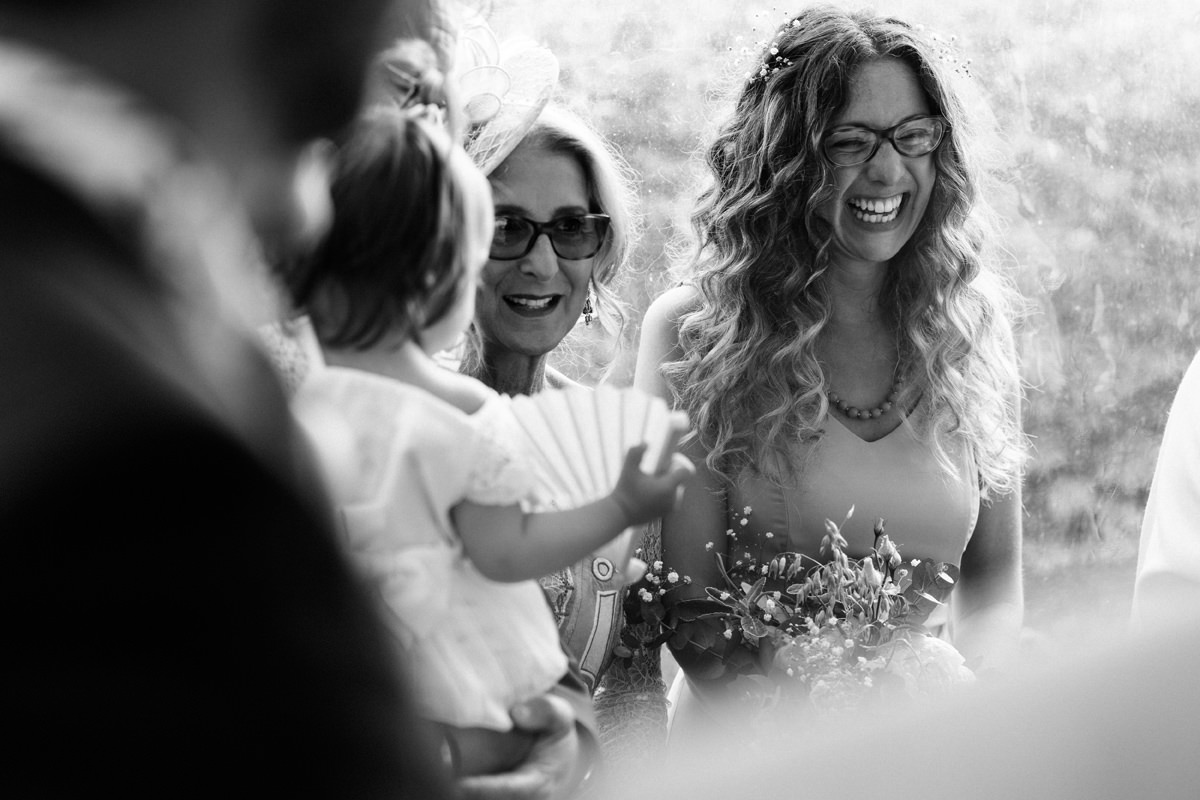sister of bride laughing during the ceremony