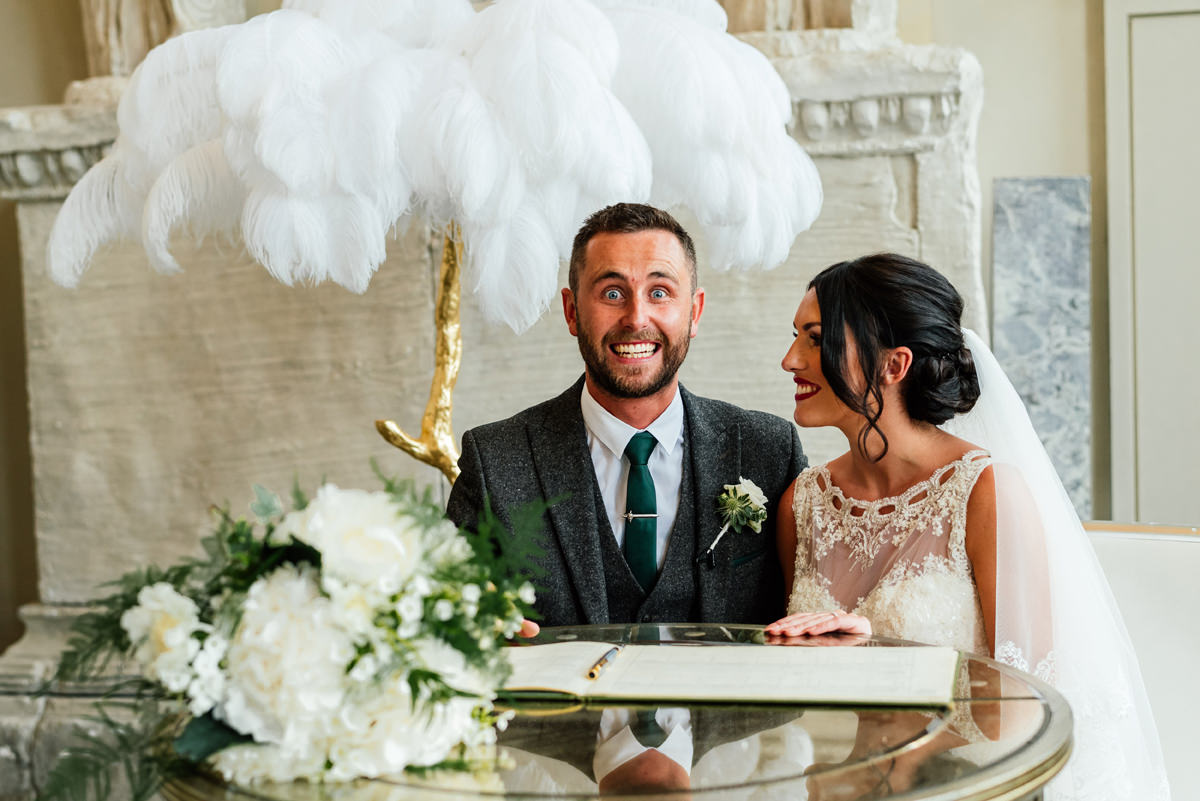 groom pulls silly face during photos