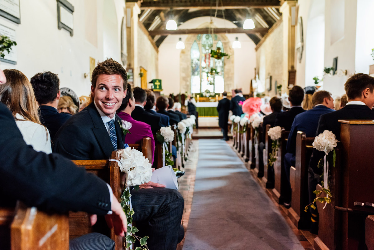 guest looks back and chats with friends in church cermony