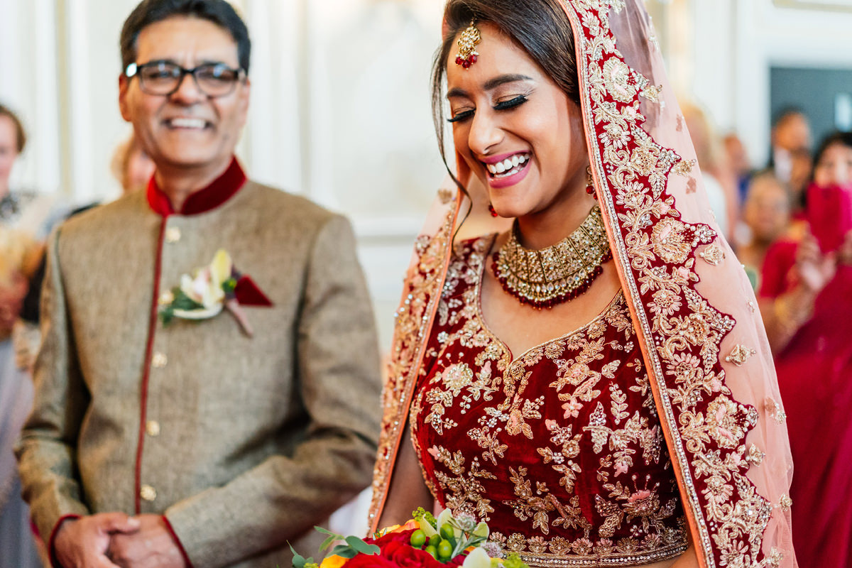 indian wedding ceremony with bride in traditional wedding dress