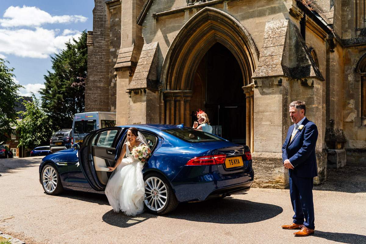 bride arrives at the church in her wedding car