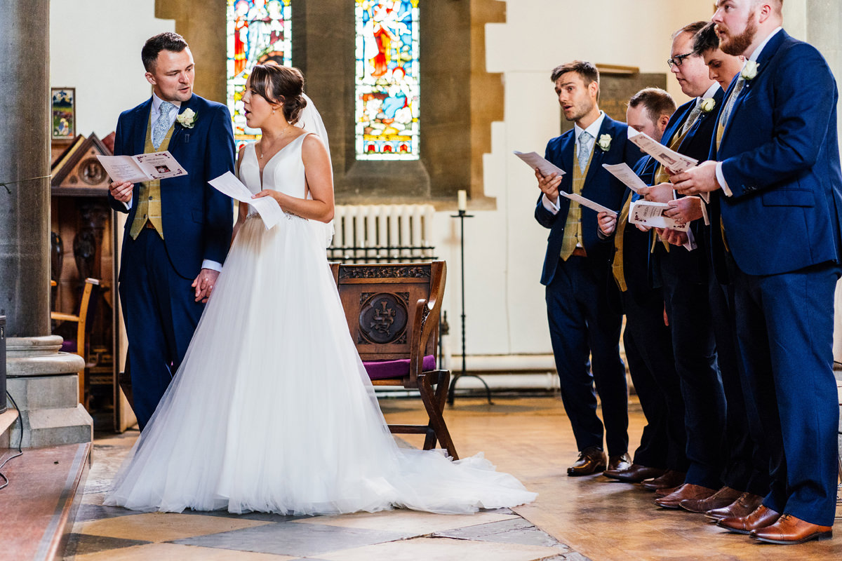 Singing hymns during the wedding ceremony at Buckingham chuch