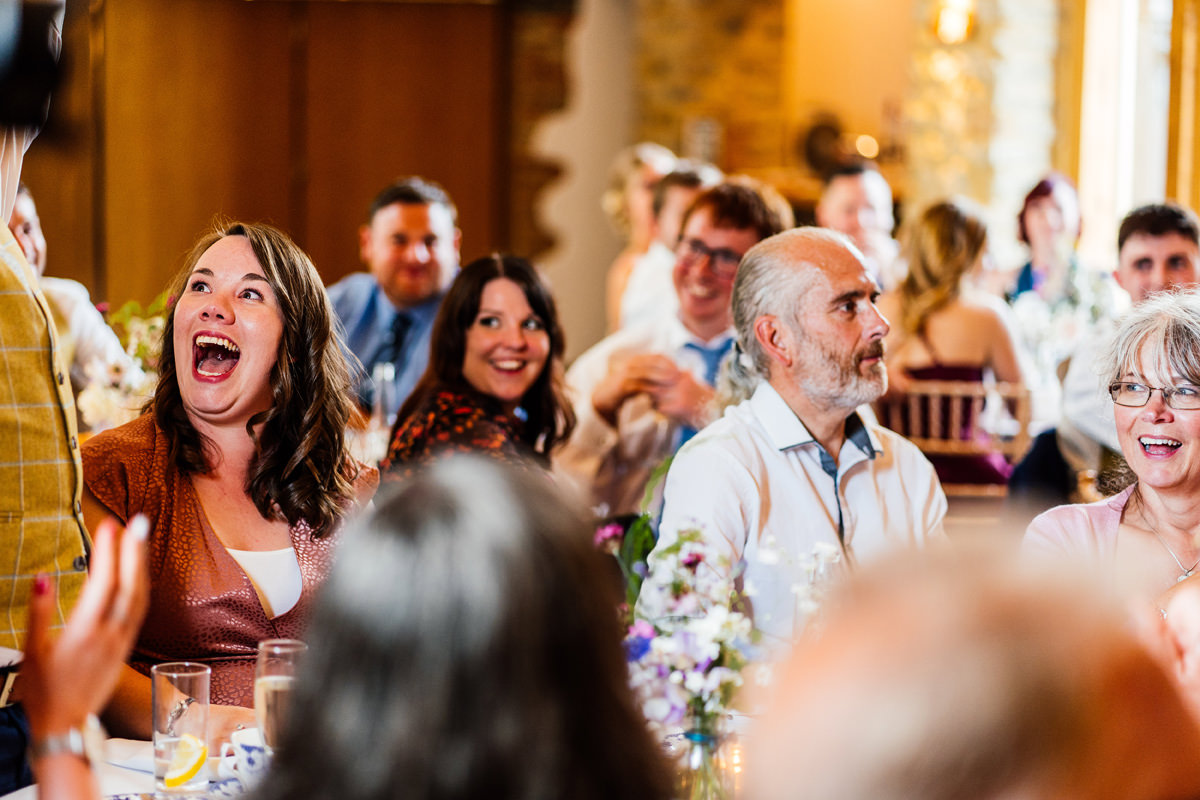 guests laughing during the speeches