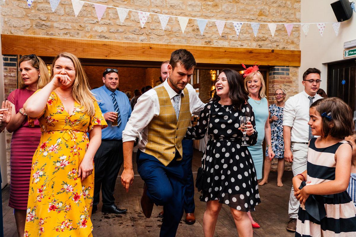 wedding guests enjoy dancing