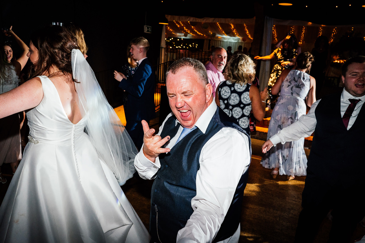 father of the groom throwing shapes on the dance floor