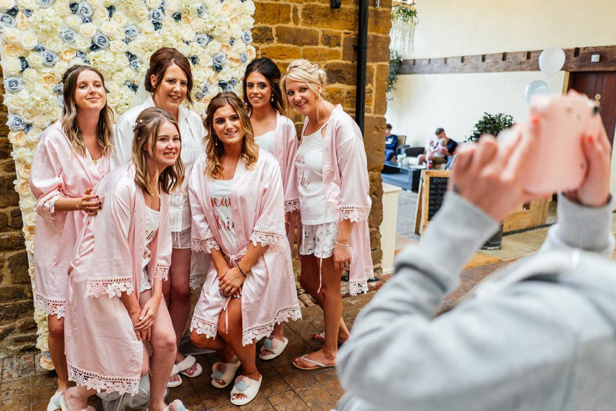 bridesmaids have their photo taken before final prep