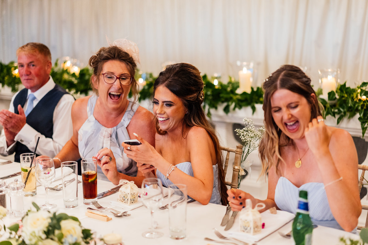 bridesmaids laughing during the wedding breakfast