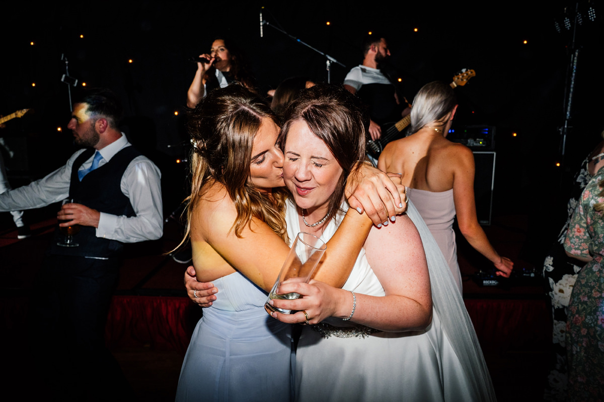 bridesmaid and bride on the dance floor
