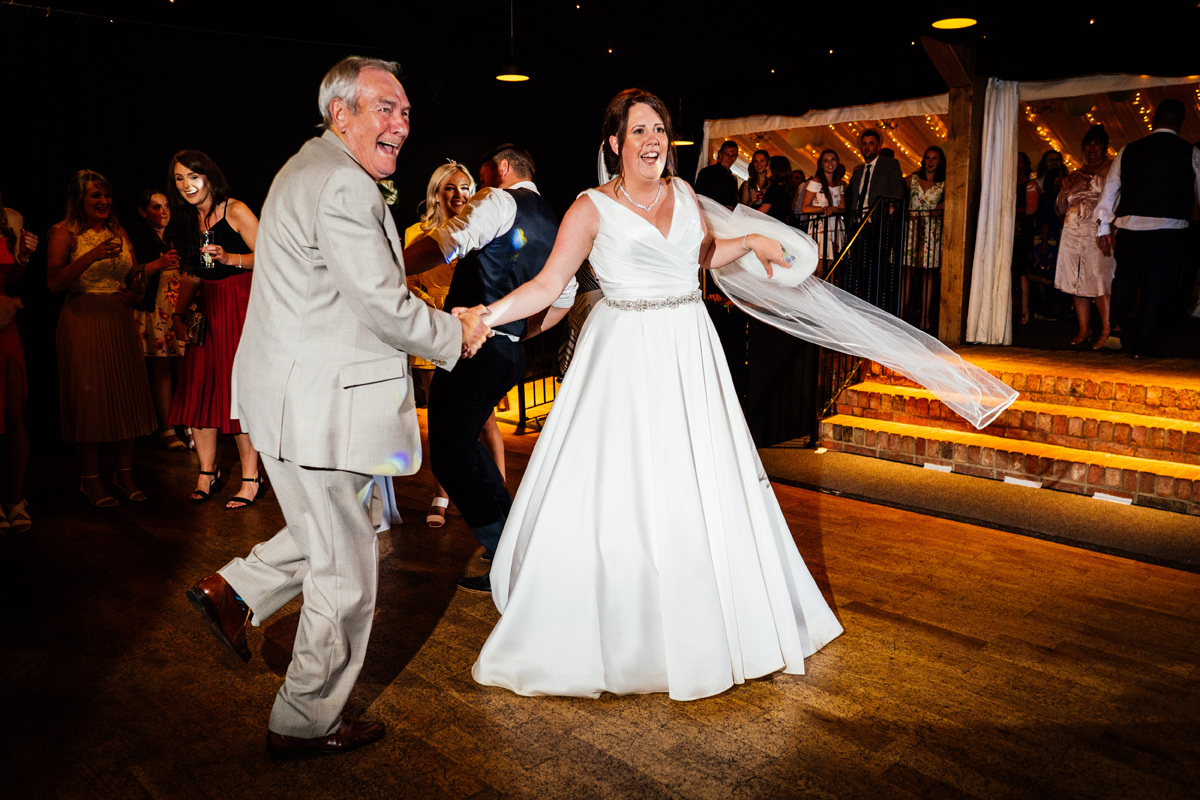 bride dances with her grandfather