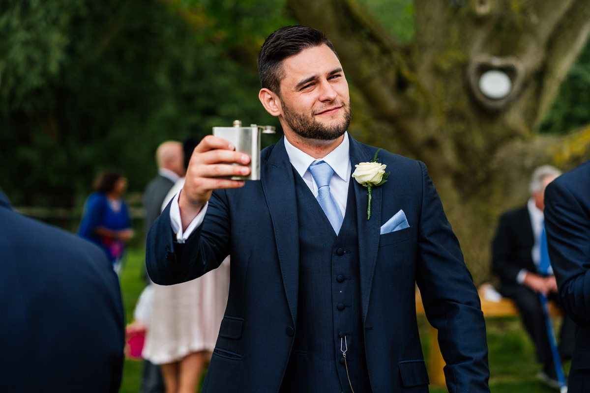 best man having a drink from his hipflask