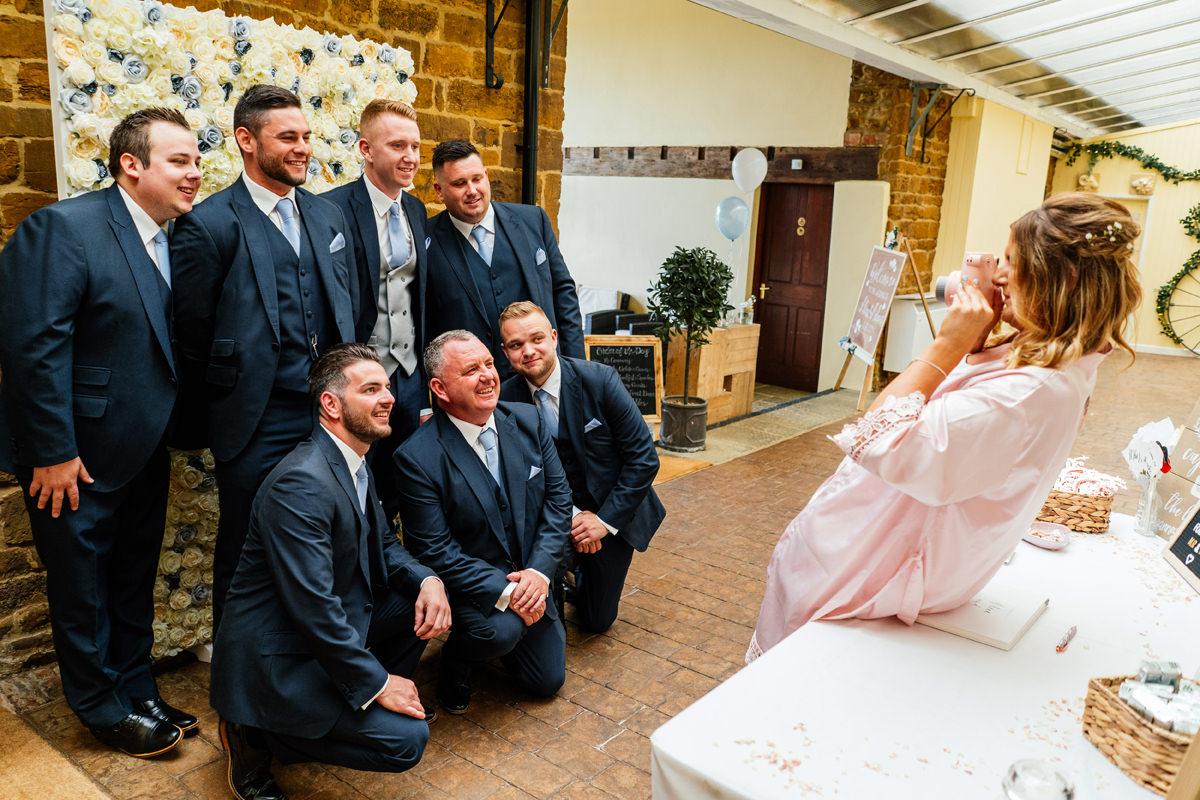 groomsmen having a group photo taken