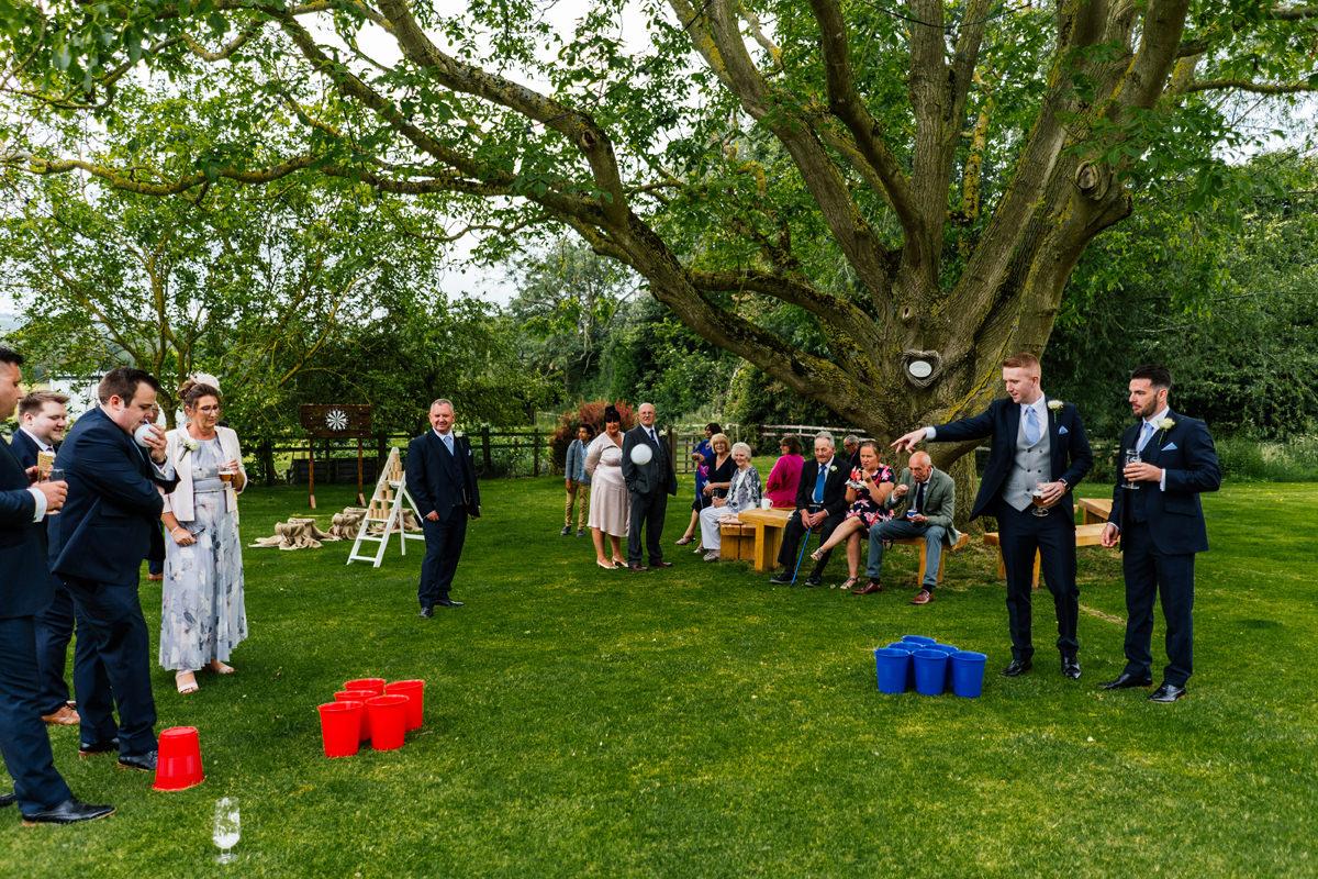 wedding guests enjoying the garden games