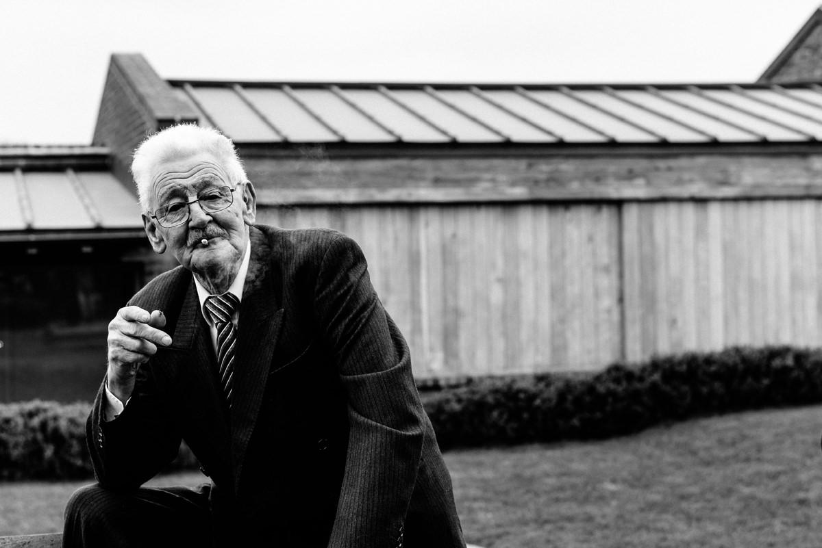 wedding guest having a cheeky smoke
