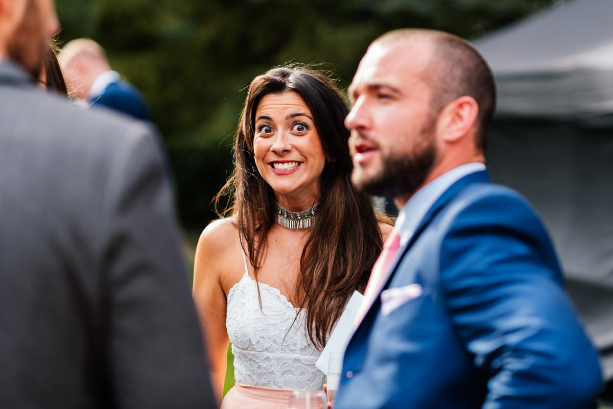 cheeky smile from wedding guest