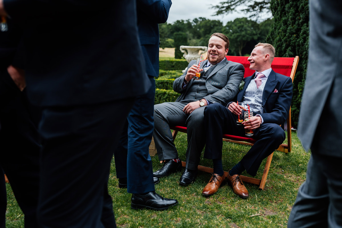 lads enjoying a drink at the wedding