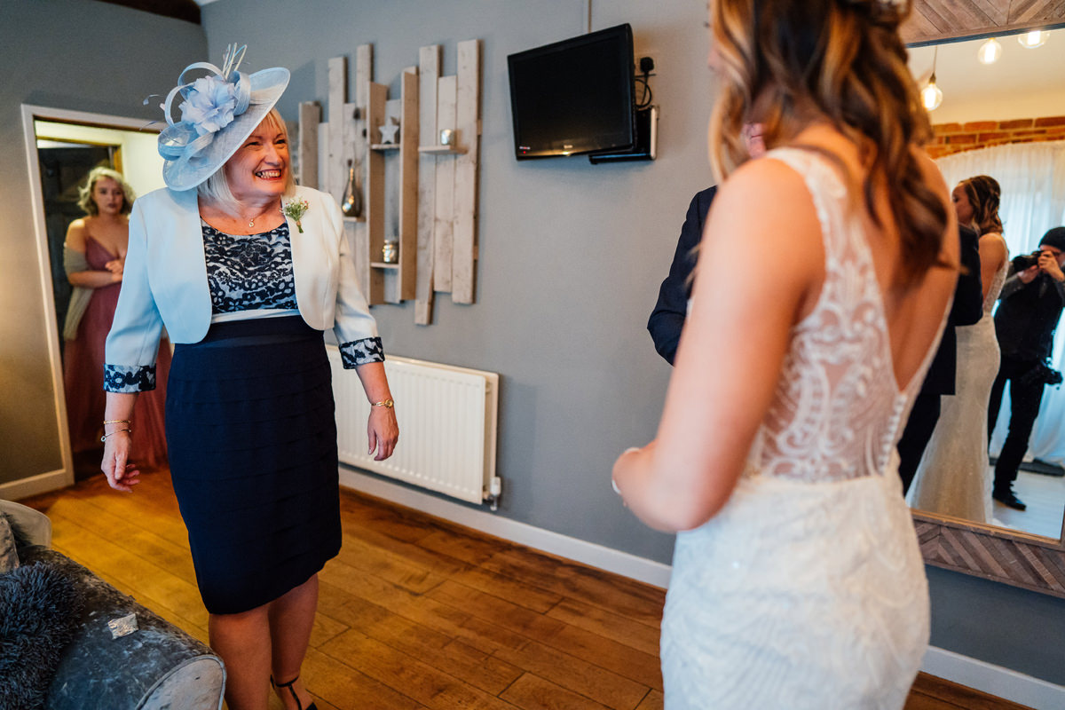 mother of the bride sees the bride in her dress for the first time