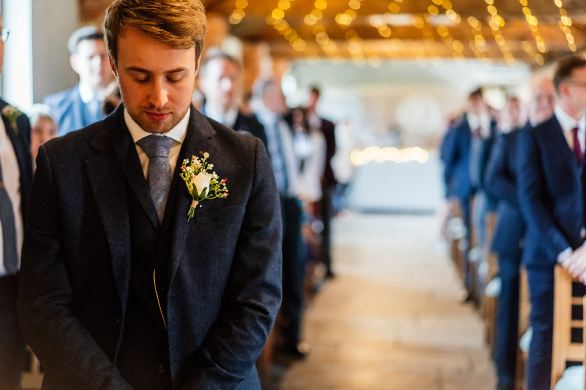 groom at the beginning of ceremony